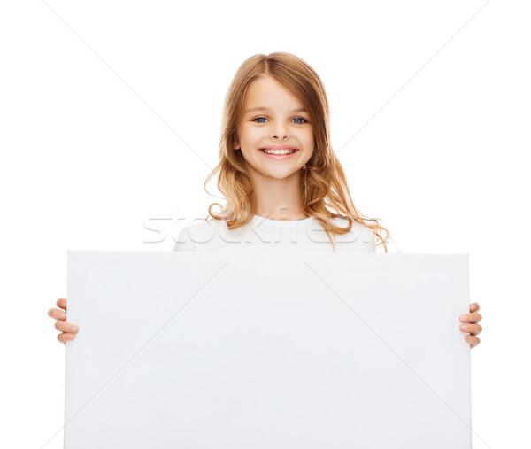 smiling little girl with blank white board Stock photo © dolgachov