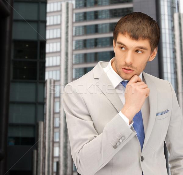 pensive businessman Stock photo © dolgachov
