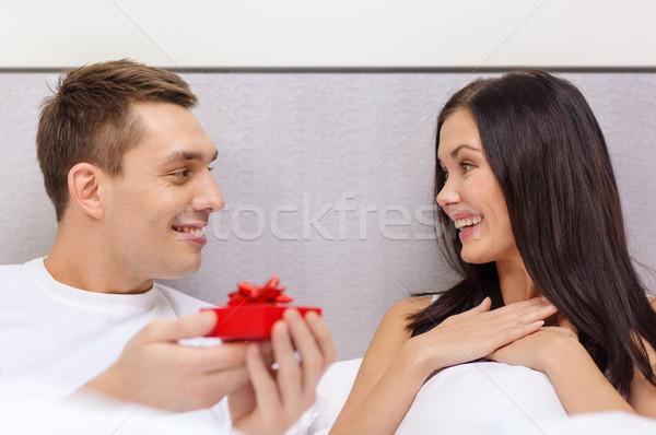 man giving woman little red gift box Stock photo © dolgachov