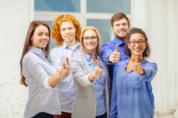 Feliz creativa equipo oficina Foto stock © dolgachov