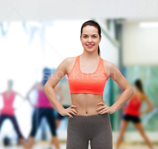 Uśmiechnięty odzież sportowa fitness diety kobieta Zdjęcia stock © dolgachov