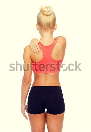 Mulher tocante ombro fitness saúde Foto stock © dolgachov