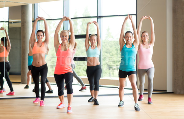 group of women working out in gym Stock photo © dolgachov