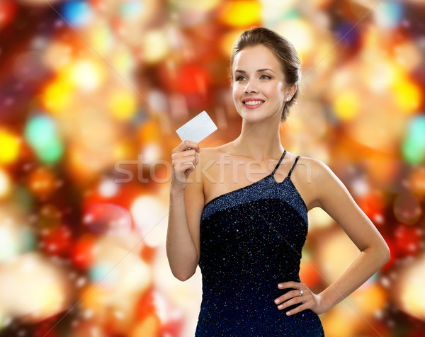 Stock photo: smiling woman in evening dress holding credit card