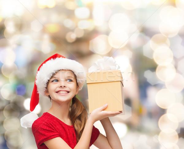 笑みを浮かべて 少女 サンタクロース ヘルパー 帽子 ギフトボックス ストックフォト © dolgachov