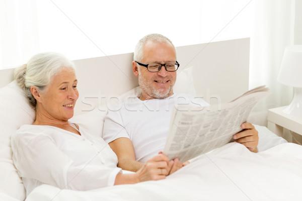 happy senior couple with newspaper in bed Stock photo © dolgachov