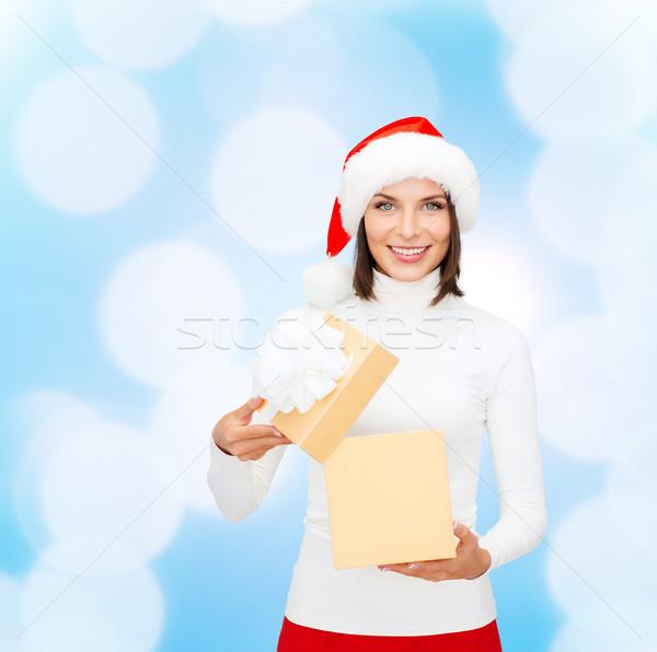 Sorrindo ajudante seis caixa de presente natal Foto stock © dolgachov