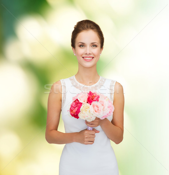 Donna sorridente abito bianco bouquet rose persone wedding Foto d'archivio © dolgachov