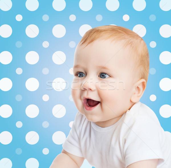Gülen bebek erkek yüz mavi lekeli Stok fotoğraf © dolgachov