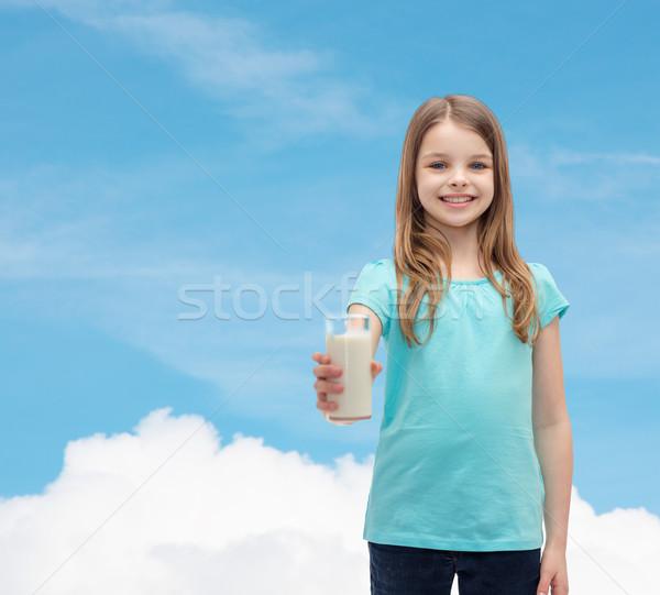 Mosolyog kislány üveg tej egészség szépség Stock fotó © dolgachov