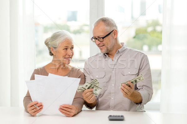 senior couple with money and calculator at home Stock photo © dolgachov