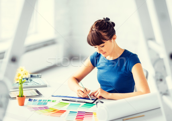 woman working with color samples for selection Stock photo © dolgachov