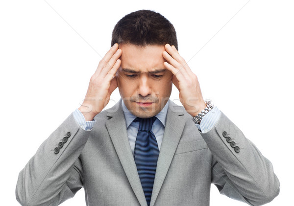 businessman in suit having head ache Stock photo © dolgachov