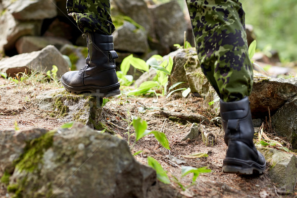 close up of soldier climbing on rocks in forest Stock photo © dolgachov