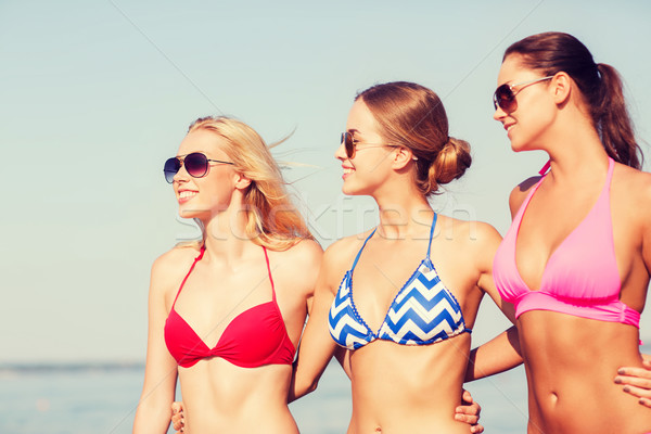 group of smiling young women in sunglasses Stock photo © dolgachov