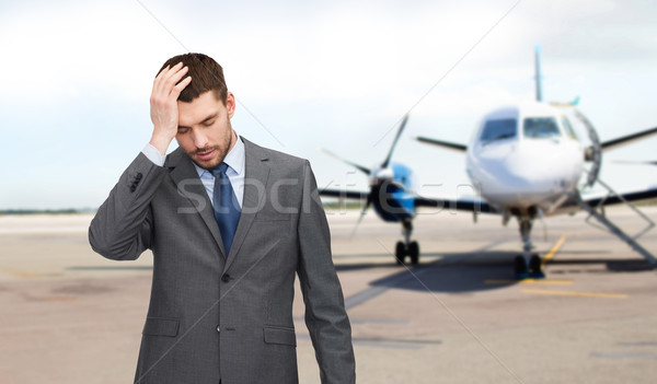 businessman over airplane on runway background Stock photo © dolgachov