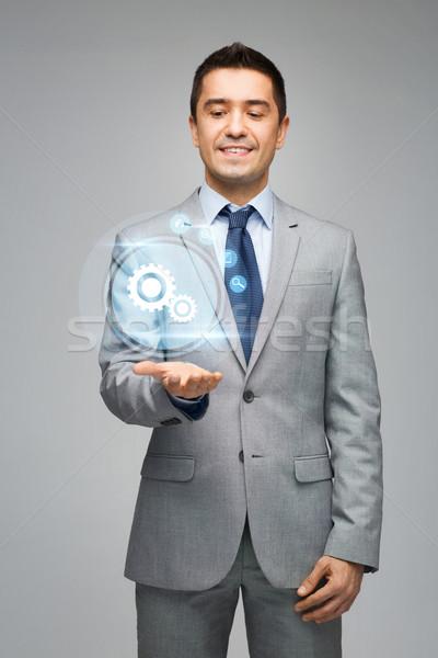 Szczęśliwy biznesmen faktyczny projekcja ludzi biznesu Zdjęcia stock © dolgachov