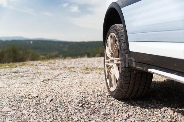 close up of dirty car wheel on cliff Stock photo © dolgachov