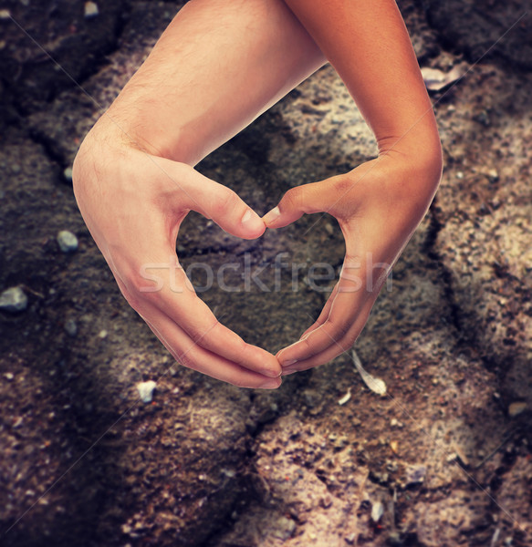 woman and man hands showing heart shape Stock photo © dolgachov