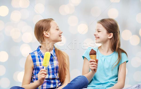 Boldog kislányok eszik fagylalt fények emberek Stock fotó © dolgachov