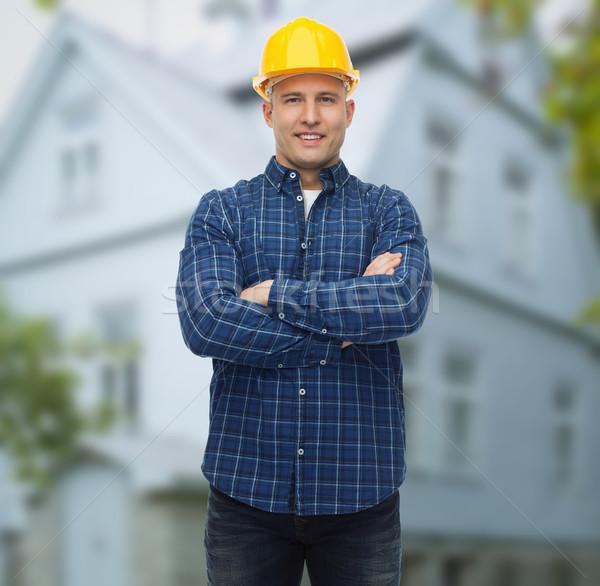 Lächelnd männlich Builder Handbuch Arbeitnehmer Helm Stock foto © dolgachov