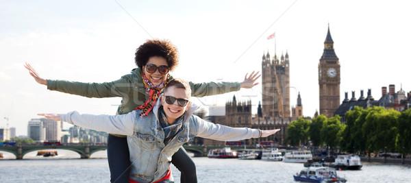 happy teenage couple having fun over london city Stock photo © dolgachov