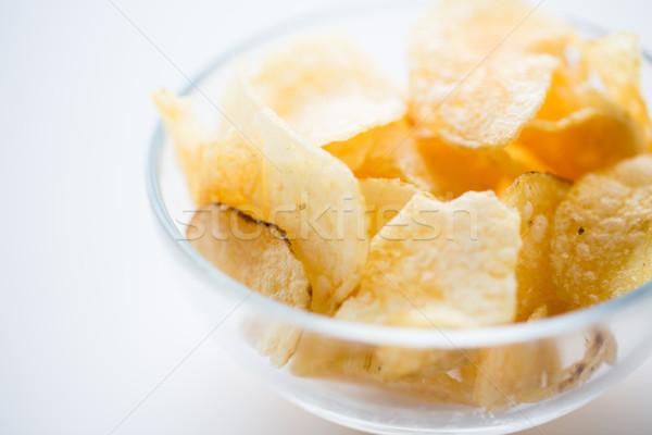 close up of crunchy potato crisps in glass bowl Stock photo © dolgachov