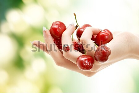 woman mouth with lips and tongue eating cherry Stock photo © dolgachov
