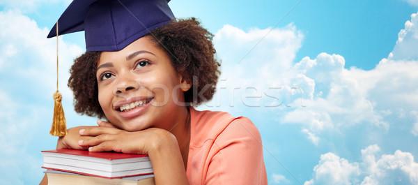 счастливым африканских бакалавр девушки книгах небе Сток-фото © dolgachov