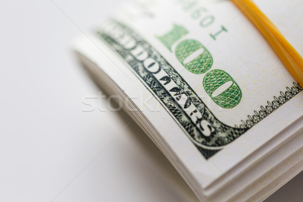 close up of dollar money packet tied with rubber Stock photo © dolgachov