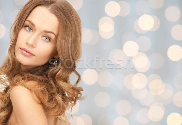 face of beautiful young happy woman with long hair Stock photo © dolgachov
