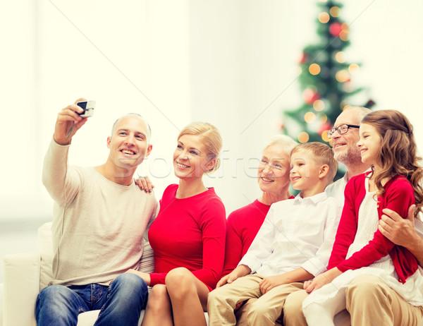 улыбаясь семьи камеры домой праздников поколение Сток-фото © dolgachov