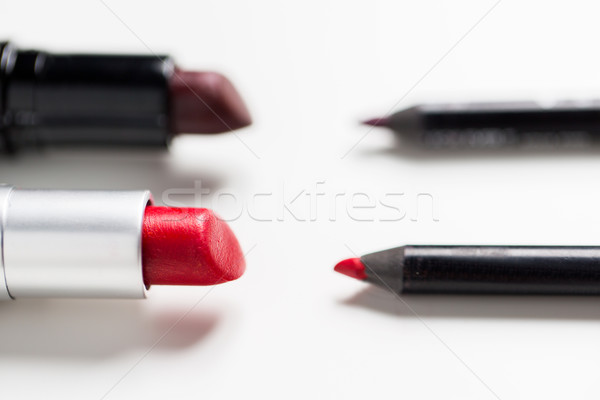 close up of two open lipsticks and lip pencils Stock photo © dolgachov
