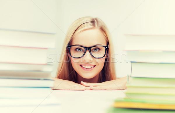 öğrenci kitaplar resim gülen kız Stok fotoğraf © dolgachov