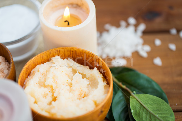 close up of natural body scrub and candle on wood Stock photo © dolgachov