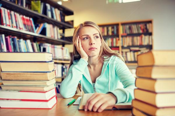 Aburrido estudiante libros biblioteca personas Foto stock © dolgachov