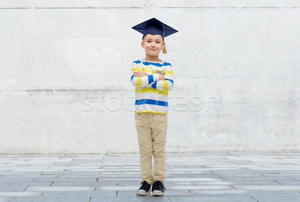 happy boy in bachelor hat or mortarboard Stock photo © dolgachov