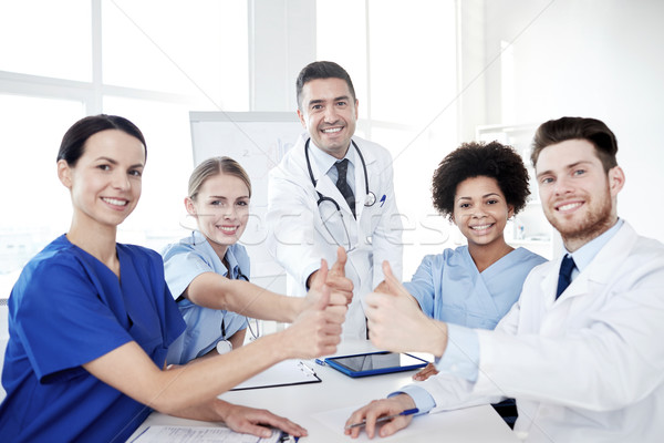 group of doctors showing thumbs up at hospital Stock photo © dolgachov