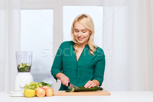 Stock photo: smiling woman with blender cooking food at home