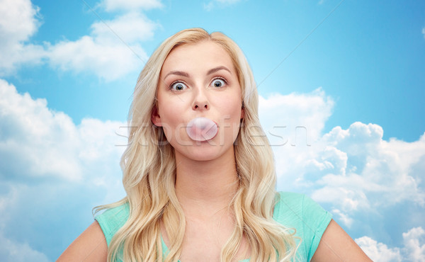 happy young woman or teenage girl chewing gum Stock photo © dolgachov
