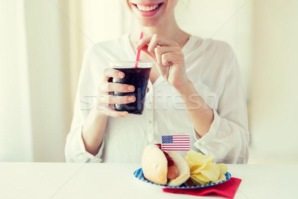 счастливым женщину питьевой Cola американский Сток-фото © dolgachov