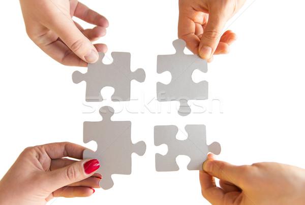 Közelkép kezek kapcsolódik kirakó darabok üzlet csapatmunka Stock fotó © dolgachov