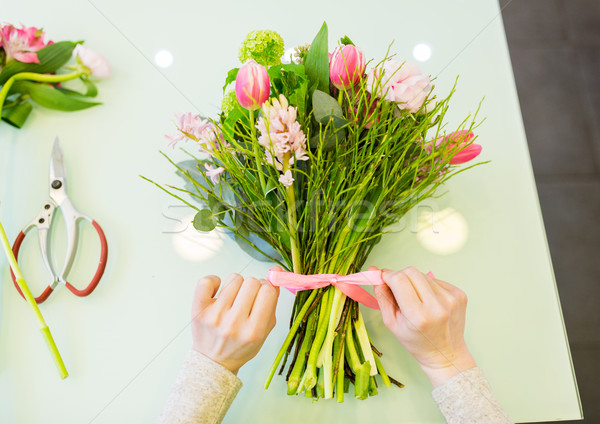 close up of woman making bunch at flower shop Stock photo © dolgachov