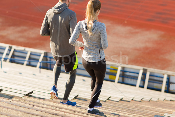 Couple courir stade fitness sport Photo stock © dolgachov