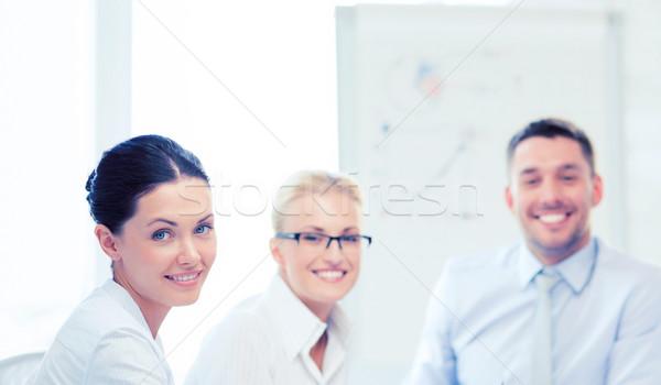 friendly business team in office Stock photo © dolgachov