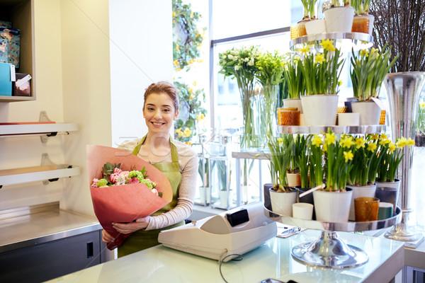 Gülen çiçekçi kadın insanlar Stok fotoğraf © dolgachov