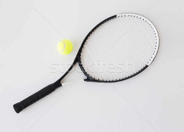 close up of tennis racket with ball Stock photo © dolgachov