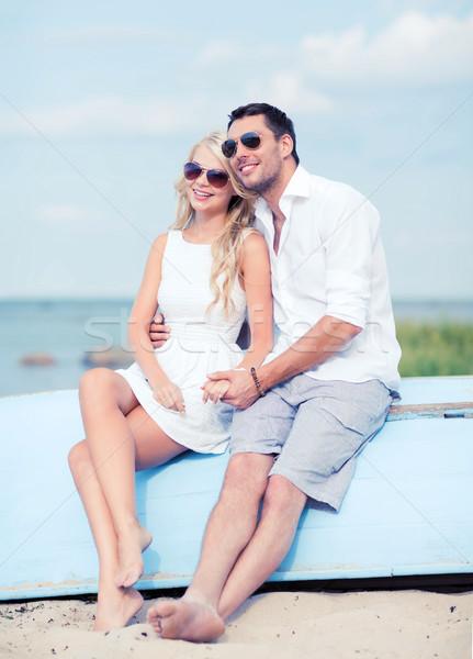 couple in shades at sea side Stock photo © dolgachov