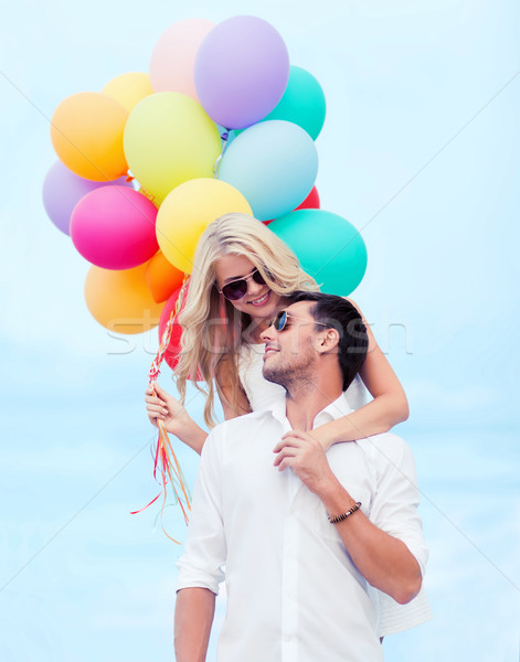 couple with colorful balloons at seaside Stock photo © dolgachov