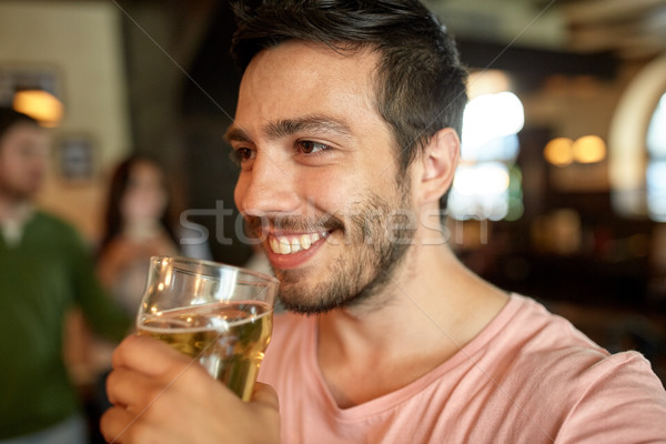 счастливым человека питьевой пива Бар Сток-фото © dolgachov